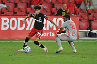 WASHINGTON, DC - SEPTEMBER 12: Kevin Paredes #30 of D.C. United battles for the ball with Cristian Casseres Jr. #23 of New York Red Bulls during a game between New York Red Bulls and D.C. United at Audi Field on September 12, 2020 in Washington, DC.