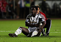 Pictured: Wilfried Bony of Swansea gets treatment from team physio after a challenge with Liverpool goalkeeper Simon Mignolet.<br /> Monday 16 September 2013<br /> Re: Barclay's Premier League, Swansea City FC v Liverpool at the Liberty Stadium, south Wales.
