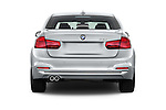 Straight rear view of 2017 BMW 3-Series 330i 4 Door Sedan Rear View  stock images