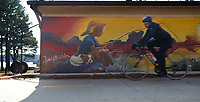 A cyclist rides Saturday, Jan. 9, 2021, past a mural on the back of the Lake Fayetteville bait shop and marina in Fayetteville. The mural was painted by Fayetteville native artist Amy Eichler. Visit nwaonline.com/210110Daily/ for today's photo gallery. <br /> (NWA Democrat-Gazette/Andy Shupe)