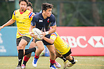 Muhammad Nazir Asaari (l) of Malaysia fights for the ball with Thailand players during the match between Malaysia and Thailand of the the Asia Rugby U20 Sevens Series 2016 on 12 August 2016 at the King's Park, in Hong Kong, China. Photo by Marcio Machado / Power Sport Images