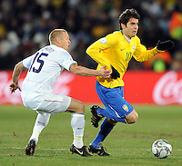 Kaka of Brazil and Jay DeMerit of USA. USA leads Brazil 2-0 after the first half during the FIFA Confederations Cup Final at Ellis Park Stadium in Johannesburg, South Africa on June 28, 2009.