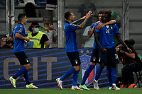 Moise Kean of Italy celebrates with team mates after scoring the goal of 2-0 during the Qatar 2022 world cup qualifying football match between Italy and Lithuania at Citta del tricolore stadium in Reggio Emilia (Italy), September 8th, 2021. Photo Andrea Staccioli / Insidefoto