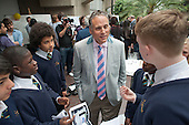 Students from St Matthew Academy in Blackheath promote their Promise Keeper smartphone app to Bryan Jones, a Dell Executive Director, at the Apps for Good Awards 2012, the Barbican, London.