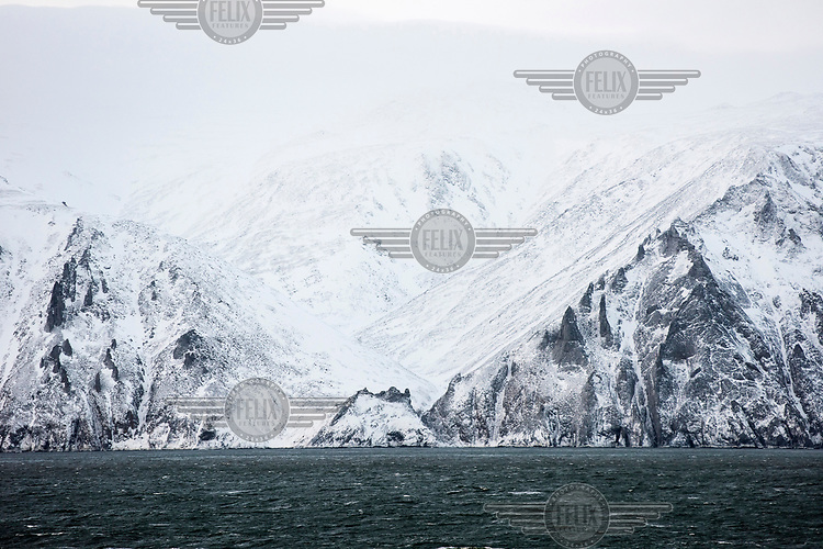 The snow covered Dezhnev Cape in Bering Strait , the end point of the Northern Sea Route.