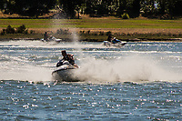 A visitor to the MLK Regional Shoreline near Oakland, California's airport churns up the water with his jet ski.