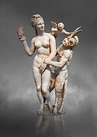 Hellenstic marble statue group of Aphrodite (Venus) with Pan and Eros, Circa 100 BC, House of Poseidonaistai of Beryttos, Delos, Athens National Archaeological Museum.  Cat no 3335. Against grey.<br /> <br /> The nude goddess Aphrodite (Venus) attempte to fend off goat footed Pan who make erotic advances towards her. Aphrodite holds a sandal in her right hand threatening Pan while the winged god Eros comes to her aid. According to an inscription on the statues base it was dedicated to Dionysus of Beryttos (Beirut) to hai ancestral gods.