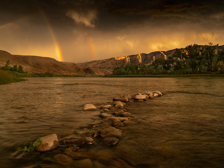 Double rainbow forms over the Green River and Split Mountain area during a morning storm in Dinosaur National Monument, UT