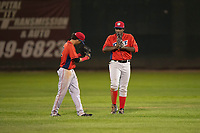 Orem Owlz outfielders Rayneldy Rosario (12) and Johan Sala (25) celebrate a victory after a Pioneer League game against the Helena Brewers at Kindrick Legion Field on August 21, 2018 in Helena, Montana. The Orem Owlz defeated the Helena Brewers by a score of 6-0. (Zachary Lucy/Four Seam Images)