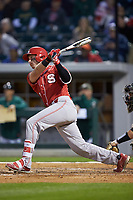 Andrew Knizner (11) of the North Carolina State Wolfpack follows through on his swing against the Charlotte 49ers at BB&T Ballpark on March 29, 2016 in Charlotte, North Carolina. The Wolfpack defeated the 49ers 7-1.  (Brian Westerholt/Four Seam Images)