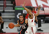 Georgia Mikal Starks (23) drives the ball, Saturday, January 9, 2021 during the second half of a basketball game at Bud Walton Arena in Fayetteville. Check out nwaonline.com/210110Daily/ for today's photo gallery. <br /> (NWA Democrat-Gazette/Charlie Kaijo)