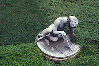 Time and thyme: sundial statue amid creeping herb thymes. Thymus. A garden play on words!