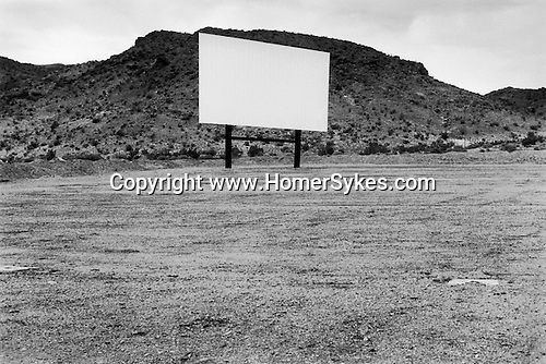 Barstow, California, USA June 2001. An empty drive in movie theatre with giant empty screen.