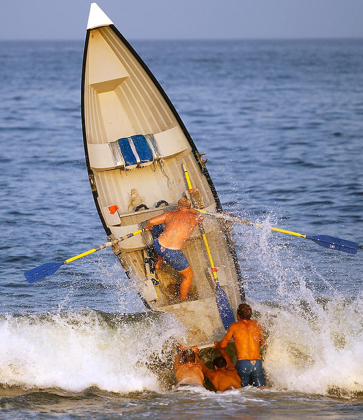 MANASQUAN, NJ - Ted Olsen from Monmouth County Parks System is rocketed nearly vertical when his Asay surfboat is launched through a wave at the Harry McCarthy Manasquan Invitational Lifeguard Tournament Aug. 17, 2010. .