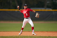 Second baseman Derick Bonilla (2) throws to first base during the Perfect Game National Underclass East Showcase on January 23, 2021 at Baseball City in St. Petersburg, Florida.  (Mike Janes/Four Seam Images)