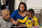 5 year old girl at home with father and stepmother, activity doing wooden puzzle together