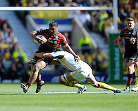 Mako Vunipola of Saracens is tackled by Nathan Hines of ASM Clermont Auvergne during the Heineken Cup semi-final match between Saracens and ASM Clermont Auvergne at Twickenham Stadium on Saturday 26th April 2014 (Photo by Rob Munro)