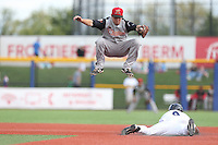 Christian Lichtenthaler of the Salem-Keizer Volcanoes leaps to avoid Fernery Ozuna (9) of the Hillsboro Hops as he slides into second base during a game at Ron Tonkin Field on July 26, 2015 in Hillsboro, Oregon. Hillsboro defeated Salem-Keizer, 4-3. (Larry Goren/Four Seam Images)