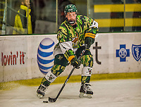 24 November 2013: University of Vermont Catamount Defenseman Nick Bruneteau, a Senior from Omaha, NB, in first period action against the University of Massachusetts Minutemen at Gutterson Fieldhouse in Burlington, Vermont. The Cats wore special camouflage jerseys to celebrate Military Appreciation Day. The game-worn jerseys were auctioned off with proceeds benefiting the Vermont Veterans Fund (VVF). The Catamounts shut out the Minutemen 2-0 to sweep the 2-game home-and-away weekend Hockey East Series. Mandatory Credit: Ed Wolfstein Photo *** RAW (NEF) Image File Available ***