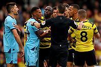 25th September 2021; Vicarge Road, Watford, Herts,  England;  Premier League football, Watford versus Newcastle; William Troost-Ekong of Watford and Federico Fernández of Newcastle United are separated by team mates