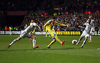 Swansea, UK. Thursday 20 February 2014<br /> Pictured: Jose Callejon of Napoli (C) takes a shot which goes wide<br /> Re: UEFA Europa League, Swansea City FC v SSC Napoli at the Liberty Stadium, south Wales, UK