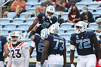 CHAPEL HILL, NC - OCTOBER 10: Dazz Newsome #5 of North Carolina celebrates his 12-yard touchdown reception with teammates Brian Anderson #68, Marcus McKethan #73, and Asim Richards #72 during a game between Virginia Tech and North Carolina at Kenan Memorial Stadium on October 10, 2020 in Chapel Hill, North Carolina.