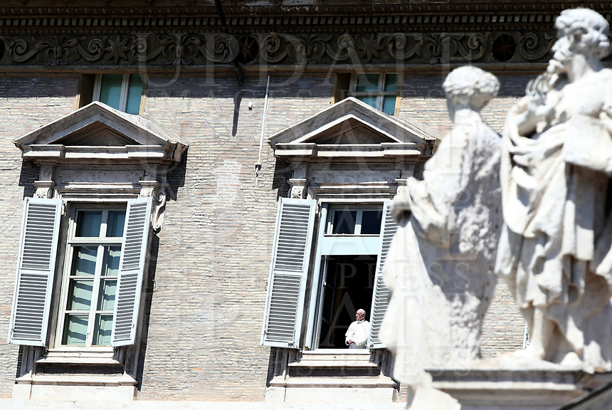 Pope Francis looks on from the window of the Apostolic palace overlooking St. Peter's Square after holding a private live streamed weekly Angelus prayer from the palace's library on April 26, 2020 in the Vatican, during the lockdown aimed at curbing the spread of the COVID-19 infection, caused by the novel coronavirus.<br /> UPDATE IMAGES PRESS/Isabella Bonotto<br /> <br /> STRICTLY ONLY FOR EDITORIAL USE