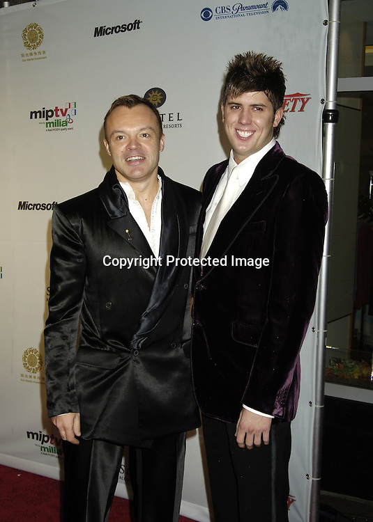 Graham Norton and Kristian Seeber..at the Arrivals of the 33rd  International Emmy Awards Gala on November 21, 2005 at the New York Hilton. ..Photo by Robin Platzer, Twin Images