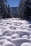 Freshly fallen snow blankets the boulders along the Big Thompson River, Rocky Mountain National Park, CO
