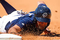 Jordan Danks #15 of the Charlotte Knights dives back into first base during an International League game against the Norfolk Tides at Knights Stadium July 5, 2010, in Fort Mill, South Carolina.  Photo by Brian Westerholt / Four Seam Images