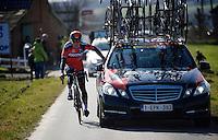 Greg Van Avermaet (BEL/BMC) is assisted by the team car after a mechanical earlier in the race<br /> <br /> Omloop Het Nieuwsblad 2015
