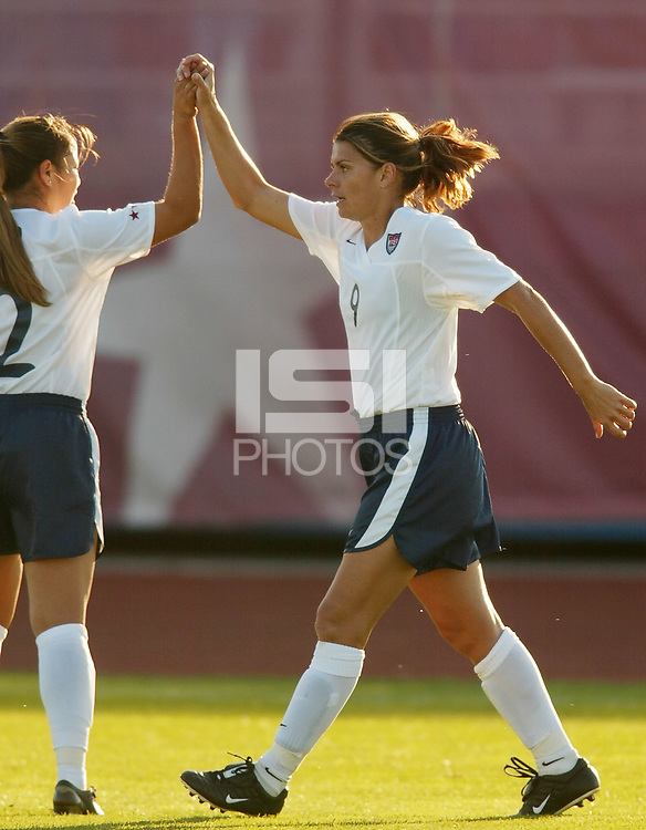 Mia Hamm celebrates her first goal of the game with Lorrie Fair. The USWNT defeated Russia 5-1 on  September 29, at Mitchel Athletic Complex, Uniondale, NY.