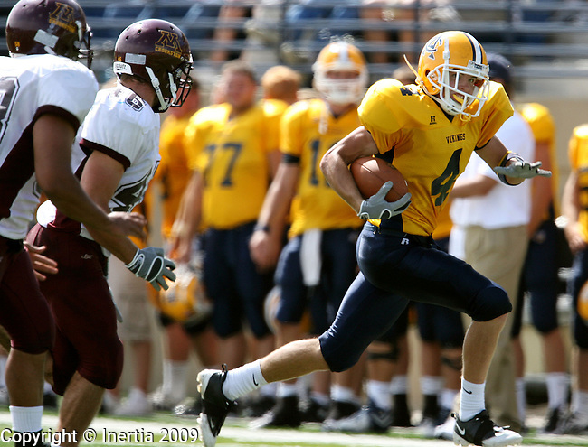 SIOUX FALLS, SD - SEPTEMBER 12:  Sam Holsen #4 of Augustana returns a punt as the Minnesota Crookston defense pursues in the second quarter Saturday afternoon at Kirkeby-Over Stadium. (Photo by Dave Eggen/Inertia).