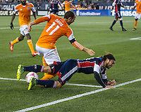 Houston Dynamo forward Brad Davis (11) and New England Revolution midfielder Lee Nguyen (24) collide near the Houston goal line.  The New England Revolution played to a 1-1 draw against the Houston Dynamo during a Major League Soccer (MLS) match at Gillette Stadium in Foxborough, MA on September 28, 2013.