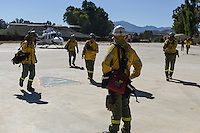 The firefighters from the BRICA, the Andalusian Service firefighting (INFOCA), are prepared to stop off into the forest fire in Los Barrios, near Cadiz on July 25, 2015. Since July 19 wildfires have ravaged nearly 39,000 hectares of land in Spain, according to the provisional figures from the agriculture ministry. © Pedro ARMESTRE