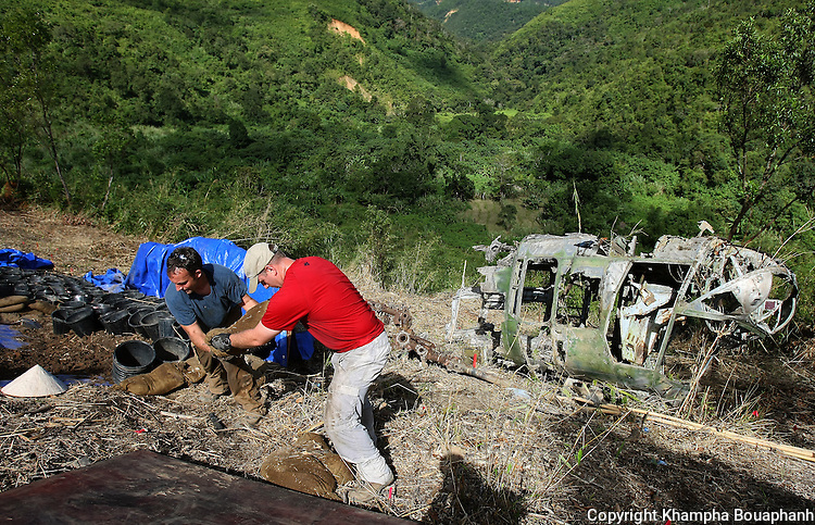 SFC Joshua Stone, left, and SFC Michael Ospina work at a JPAC dig site near Ta Oy, Laos on Wednesday, November 7, 2012. The recovery team is searching for the remains of an American Marine unaccounted for from the Vietnam war. (Star-Telegram/Khampha Bouaphanh)