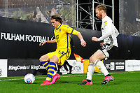 Conor Gallagher of Swansea City under pressure from Tim Ream of Fulham during the Sky Bet Championship match between Fulham and Swansea City at Craven Cottage on February 26, 2020 in London, England. (Photo by Athena Pictures/Getty Images)
