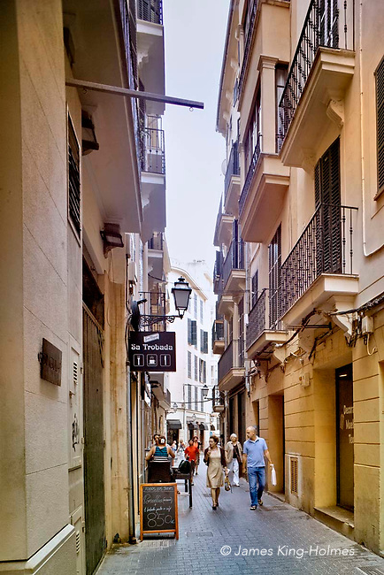 Carrer Paraires, one of the narrow shopping streets in central Palma, Majorca, Spain