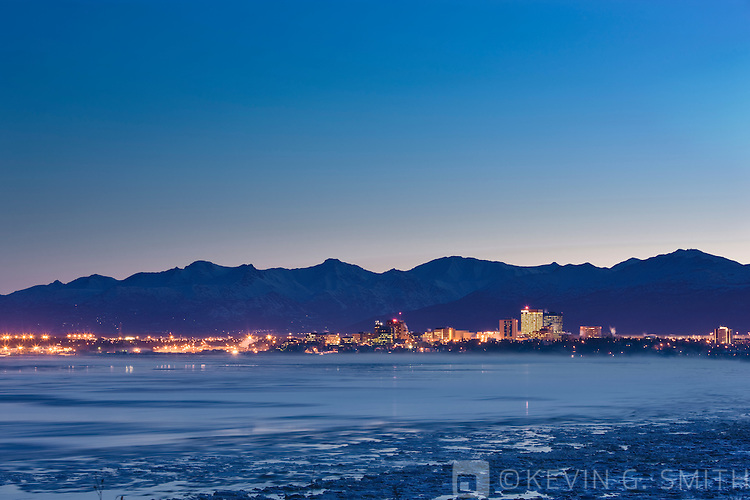 Photo of the Anchorage Skyline before dawn, fog rising from the waters of Knik Arm, taken from Earthquake park, winter, Southcentral  Alaska, USA.
