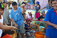 Philippines. Province Eastern Samar. Hernani. Barangay (neighbourhood) Batang. Men, women and children unroll ropes received at a distribution of non food items. Ropes will be used to tighten plastic sheetings on roofs of temporary shelters. 95 % of the town was destroyed by typhoon Haiyan's winds and storm surge. Typhoon Haiyan, known as Typhoon Yolanda in the Philippines, was an exceptionally powerful tropical cyclone that devastated the Philippines. Haiyan is also the strongest storm recorded at landfall in terms of wind speed. Typhoon Haiyan's casualties and destructions occured during a powerful storm surge, an offshore rise of water associated with a low pressure weather system. Storm surges are caused primarily by high winds pushing on the ocean's surface. The wind causes the water to pile up higher than the ordinary sea level. 24.11.13 © 2013 Didier Ruef