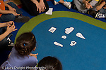 Preschool Headstart 3-5 year olds circle time teacher working with group on letter sounds seen from overhead horizontal
