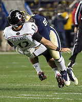 Pitt defensive lineman Aaron Donald (97) puts a hit on Cincinnati quarterback Zach Collaros. Cincinnati Bearcats defeated the Pitt Panthers 26-23 at Heinz Field in Pittsburgh, Pennsylvania on November 5, 2011.
