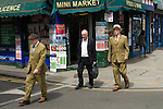 Gilbert and George who are artists walking down Brick Lane London E1. 2013
