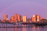 A fading rainbow at sunrise over Boston Harbor, Boston, MA, USA