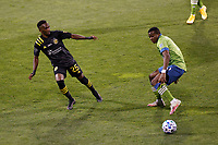 COLUMBUS, OH - DECEMBER 12: Harrison Afful #25 of Columbus Crew battles for the ball against Nouhou #5 of Seattle Sounders FC during a game between Seattle Sounders FC and Columbus Crew at MAPFRE Stadium on December 12, 2020 in Columbus, Ohio.