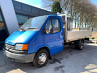 BNPS.co.uk (01202 558833)<br /> Pic: HampsonAuctions/BNPS<br /> <br /> Pictured: 1987 Ford Transit 190 Flatbed.<br /> <br /> Since the 1990s, Geoff Barlow, 46, has collected dozens of classic cars from an Escort Mexico replica to several types of Transit, Cortina, and Sierra.<br /> <br /> However, he still regrets selling the first car which inspired his passion, a 1980 Escort Mark 2 he bought from his sister in 1992.  <br /> <br /> Geoff's fascination with Fords gathered pace in the last decade and he 'lost control,' buying as many Fords as he came across and saving them from disrepair.