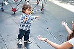 15 month old toddler baby boy walking toward mother's outstretched arms