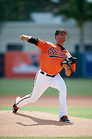 Baltimore Orioles pitcher Ofelky Peralta (74) delivers a pitch during an Instructional League game against the Atlanta Braves on September 25, 2017 at Ed Smith Stadium in Sarasota, Florida.  (Mike Janes/Four Seam Images)