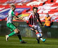 5th April 2021; Bet365 Stadium, Stoke, Staffordshire, England; English Football League Championship Football, Stoke City versus Millwall; Nick Powell of Stoke City under pressure from Scott Malone of Millwall