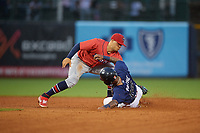 Jacksonville Jumbo Shrimp shortstop Joe Dunand (3) tags Cristian Pache (16) out on a stolen base attempt during a Southern League game against the Mississippi Braves on May 4, 2019 at Trustmark Park in Pearl, Mississippi.  Mississippi defeated Jacksonville 2-0.  (Mike Janes/Four Seam Images)